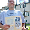 Salem: Tom Doyle shows a picture of himself from his scrapbook remebering the Salem game against Bishop Fenwick.   photo by Mark Teiwes /  Salem News