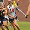 Marblehead: Marblehead's Maika Strogoff carries the ball past Arlington Catholic's Casey Cohen.  photo by Mark Teiwes / Salem News
