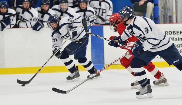 Wilmington: St. John's Prep forward Brian Pinho, left, advances the puck supported by teammate Jon Farrow, right, who scored the team's third goal against Hingham. photo by Mark Teiwes  / Salem News