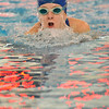 Marblehead: Danvers swimmer Andrea Lang takes a breath as the timer is reflected in the water.  photo by Mark Teiwes  / Salem News