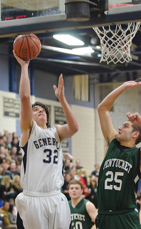 Hamilton:  Hamilton-Wenham captain Jake Prince makes a layup  defended by Pentucket's John Modlish in a Division 3 North first round state tournament game.  photo by Mark Teiwes / Salem News
