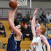 Wenham: Peabody's Fotakis Sotiri, left, goes for a lay-up  defended by Beverly's Zach Zigelbaum  photo by Mark Teiwes  / Salem News
