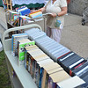 Peabody: Claire Crosby arranges books during a Friends of the Peabody Institute Library book sale with proceeds supporting library programs.  photo by Mark Teiwes /  Salem News