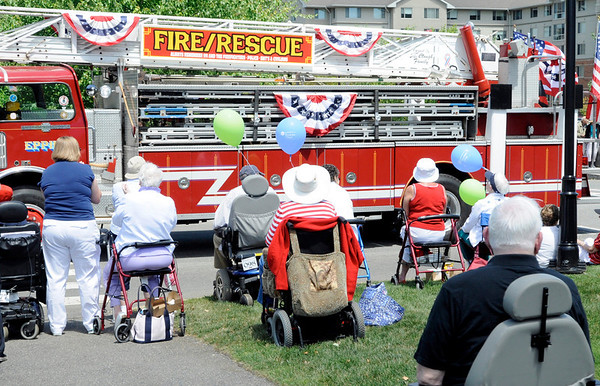 Peabody: Brooksby Village residents enjoy an early parade on Thursday to celebrate the 4th of July. photo by Mark Teiwes / Salem News