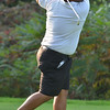 Peabody: Peabody High School's leading golfer Athan Goulos tees off on the 7th hole.      photo by Mark Teiwes / Salem News