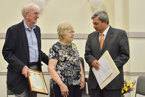 Danvers: John Toomey, left, stands with his wife Pat who is honored with a proclamation from Representative Ted Speliotis for her many years of service to the town of Danvers.  photo by Mark Teiwes /  Salem News