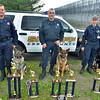 Middleton:  Essex County Sheriff's Department K-9 unit Sergeants Don Evans, left, with his partner Blitz, Steve Tsoukalas,with Dozer, and Jennifer Walsh with Jake pose outside the Middleton Jail with trophies they have won.   photo by Mark Teiwes / Salem News