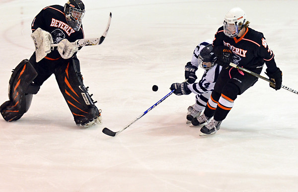Salem:  Beverly boys goalie Tony Walsh comes out of the net to flick away an attempt from Peabody's Eric Costa closely followed by Beverly's Andrew Irving.  photo by Mark Teiwes / Salem News