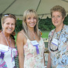 Hamilton:  Lizete Alcalai of Sagan Realtors, left, Sylvia Sasso of Shaperella, and Jeanne Earl, a Live Well coach enjoyed the networking at Green Meadows Farm.  photo by Mark Teiwes / Salem News