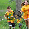 Danvers:  Matthew Rotker, 8, left, runs with counselor Marsolais after he caught a large bull frog in the pond at Endicott Park with the summer SNAKE nature program sponsored by the Danvers Recreation Department. Mark Teiwes / Salem News