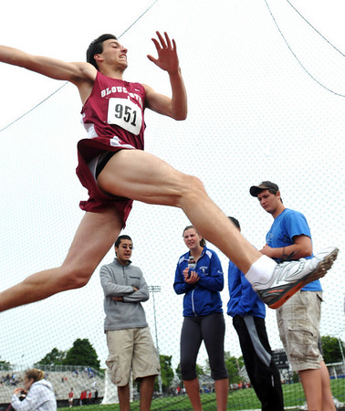 Lynn: At the Northeastern Conference track meet, Gloucester athlete James Patrican competes in the triple jump.  Photo by Mark Teiwes / Gloucester Times