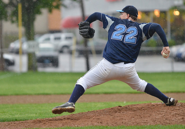 Beverly: Peabody pitcher Patrick Ruotolo takes aim in the rain for one of his many strike outs.  photo by Mark Teiwes / Salem News