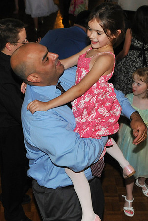 Peabody: John Kritikos dances with his daughter Ella at the annual father/daughter ball.  photo by Mark Teiwes / Salem News