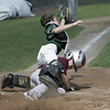 Danvers:  Danvers National Little League player Jackson McPherson, right, slides home to score, taking out Groveland catcher Anthony Orlando in a District 15 game. photo by Mark Teiwes / Salem News