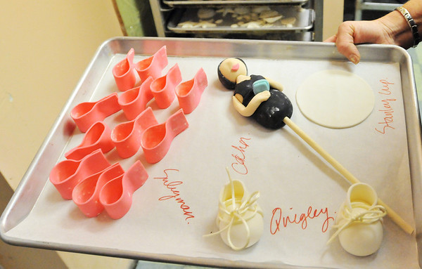 Danvers:  Edible details are ready for various party themed cakes at Cakes for Occasions.  photo by Mark Teiwes / Salem News