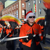Beverly: Emily Harting, walks with the Beverly High School marching band at yesterday's Beverly holiday parade. photo by Mark Teiwes / Salem News