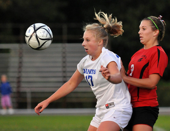 Danvers:  Danvers High School girls soccer player Corey Persson, left, receives a pass defended by Salem's Lauren Schaejbe.  photo by Mark Teiwes / Salem News