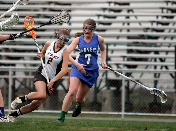 Beverly: Beverly's Mandy Cecchini, left, sprints on attack past Danvers defender Julia Calasciebetta.  photo by Mark Teiwes