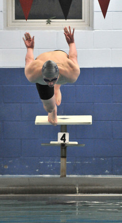 Salem: Hamilton-Wenham swimmer Andrew Klobucher takes off on his way to win the 100 meter breast stroke.  photo by Mark Teiwes  / Salem News