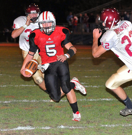 Salem: Salem quarterback Brad Skeffington, left, runs for the team's first touchdown past Gloucester defensman Adam Philpott.  photo by Mark Teiwes / Salem News