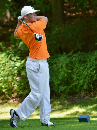 Boxford: Ernie Lupi of Haverhill follows through after teeing off on the 18th hole for the North Shore Amateur golf tournament at the Far Corner golf course.  photo by Mark Teiwes /  Salem News