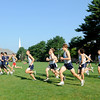 Wenham: Runners take off from the starting line on the quad during a Gordon College and Salem State cross country match.   photo by Mark Teiwes / Salem News