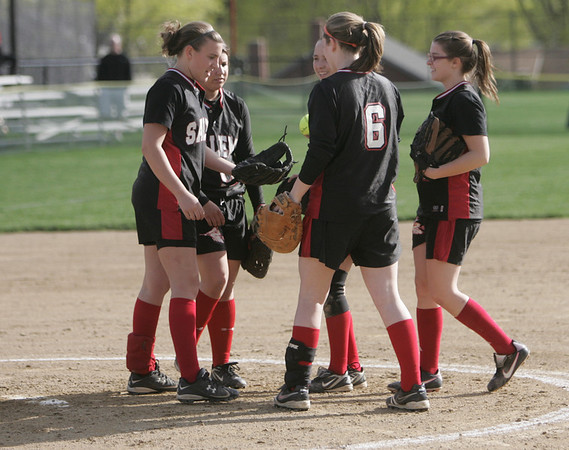 Salem: Salem High School softball infielders come together after a key play to keep momentum in the game. photo by Mark Teiwes / Salem News