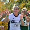 Beverly: Endicott College women's soccer captain Kayla Corbett of Danvers slaps hands with teammates prior to a match against Salve Regina.   photo by Mark Teiwes / Salem News