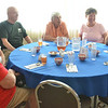 Ipswich: From left, Reta Pelletier, Kay Kellie, Mashall Powden, Gini Player, and Sally and Bob Kiesling share a laugh at the start of the meal.  The twice weekly meal is a chance for people to meet and socialize, especially meaningful for people who normally eat alone.   photo by Mark Teiwes /  Salem News