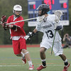 Wenham: Hamilton-Wenham's Sam Martinez, right, advances covered by Masco's Topher Jung.   photo by Mark Teiwes / Salem News