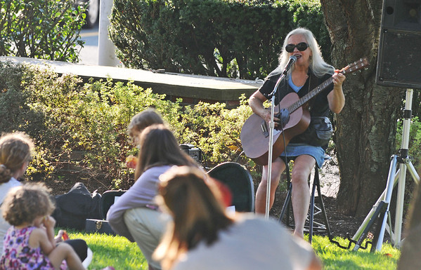 Beverly: Julie Dougherty performs at the Beverly Farmers' Market.  Next week will be the last market of the season.  photo by Mark Teiwes / Salem News