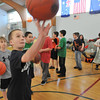 Beverly: Justin Loreti, 10,  puts up a shot at the Beverly-Salem Elks Club free throw contest photo by Mark Teiwes  / Salem News