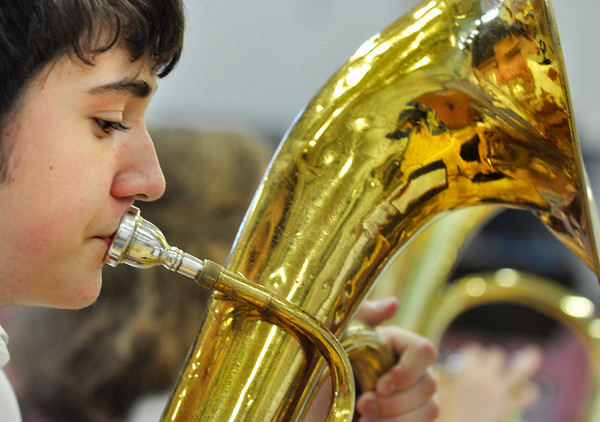 "Salem: 8th grader Brian Dunning plays the song ""Sugar Train"" on his baritone horn with the jazz band at Collins Middle School's final concert. photo by Mark Teiwes / Salem News"