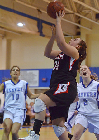 Danvers: Salem captain Amanda Wilkins makes a breakaway layup past the Danvers defense. photo by Mark Teiwes / Salem News