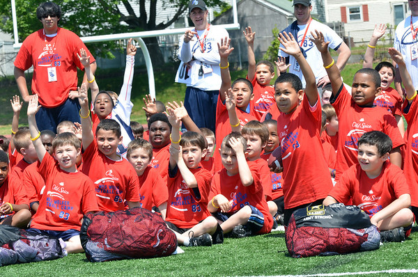 Peabody:  Young football players are eager to show off their skills at West Welker's Football Camp.  photo by Mark Teiwes / Salem News