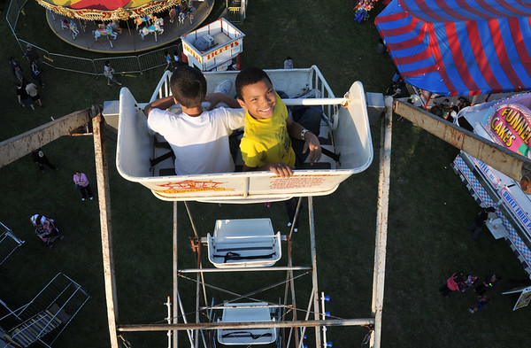 Dyrece Robinson, 11, of Beverly looks up as he rides a ferris wheel with his friend Issac Baer, 9, of Danvers.  Carnival proceeds benefit the Beverly Education Foundation.  Photo by Mark Teiwes / Salem News