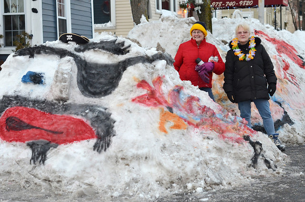 Salem:  Anita Armell, left, and Sheila Lawler used the freshly plowed show as a canvas.  Their paintings included a pirate, fireman, and a portrait.  photo by Mark Teiwes  / Salem News