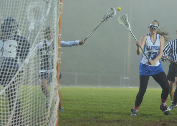 Danvers: Danvers player Sarah Witt rockets a shot on to score past Swampscott's goalie Samantha Coogan.   photo by Mark Teiwes / Salem News