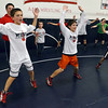 Danvers: Collin Vallis of Boxford, 10, left, Charlie Galanis, of Ipswich, 13, and Jack Darling of Boxford, 9, lead warmups for the North Shore Youth Wrestling clinic.    photo by Mark Teiwes / Salem News