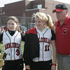 Marblehead: Marblehead softball co-captain, Emmy York, left, pitcher Sarah Hastings, and coach Johnny Gold meet with the umpire before a game against Winthrop.   The team is dedicating its season to coach Johnny Gold's sister, Ruth Paster, who died of breast cancer during the winter.   photo by Mark Teiwes / Salem News