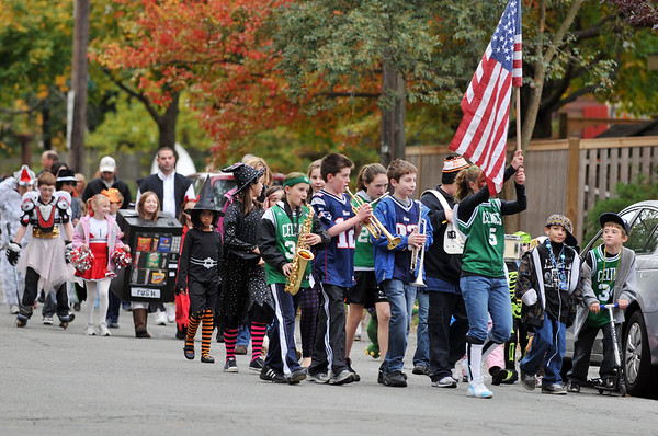 Beverly: Costumed families march down County Way during the neighborhood's annual neighborhood Halloween parade. photo by Mark Teiwes / Salem News