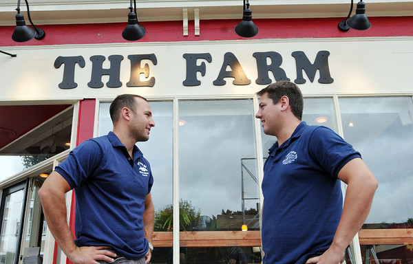 Beverly:  Noah Goldstein, left, and Ryan Cox talk outside their new restaurant in Beverly opening today.  Their restaurant in Essex has over two thousand facebook fans.  The Beverly restaurant has over two hundred before its opened.