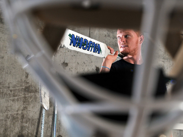 Swampscott: Cory Schneider of Swampscott, a goalie for the Vancouver Canucks is seen through his goalie mask. photo by Mark Teiwes / Salem News