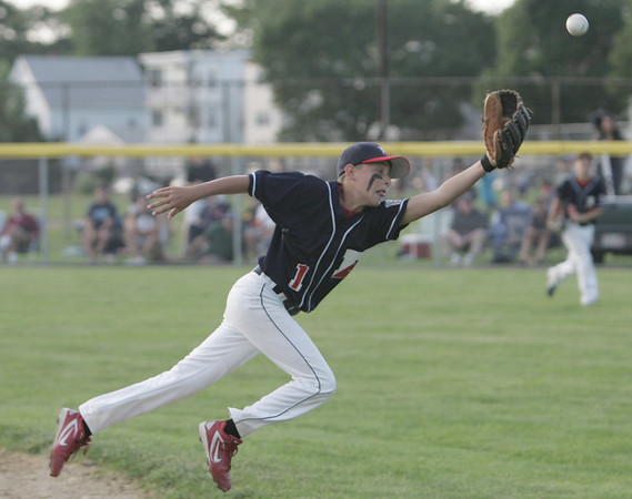 Lynn: Peabody West Little League second baseman Matt Damato dives for a ball out of his reach.  photo by Mark Teiwes  / Salem News