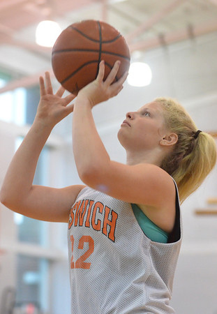 Danvers: Ipswich player Jordan Morrissey puts up a shot in the North Shore High School Girls Summer Basketball League.  photo by Mark Teiwes / Salem News