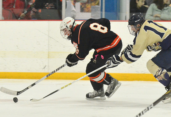 Stoneham: Beverly's Troy Cabral skates past Winthrop's Mitch Paulson. photo by Mark Teiwes