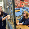 Middleton: Angela Seeley, left, and Amanda Powers are part of the North Shore Technical High School automotive technology program. photo by Mark Teiwes / Salem News