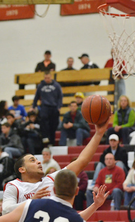 Salem: Salem's Antonio Reyes makes a layup defended by Peabody's Brian DeAngelis.  photo by Mark Teiwes  / Salem News