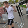 Peabody: Bishop Fenwick hurdlers Andrew Regan, left, and Charlie Maistrellis set up hurdles for practice.  photo by Mark Teiwes