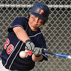 Tewksbury: Peabody West's Hunter Jacques keeps his eye on the ball.  photo by Mark Teiwes / Salem News
